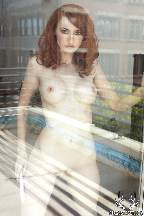 kendra james looks out the window