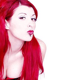 BlueBloods GothicSluts corset-clad hottie with cherry red hair