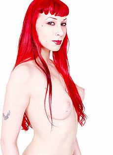 BlueBloods GothicSluts redhead goth chick strips off fetishwear spreads