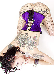 BlueBloods GothicSluts collared goth girl in corset fishnet restraints