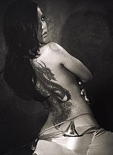 BlueBloods GothicSluts tattooed Eurasian beauty on fur in black and white